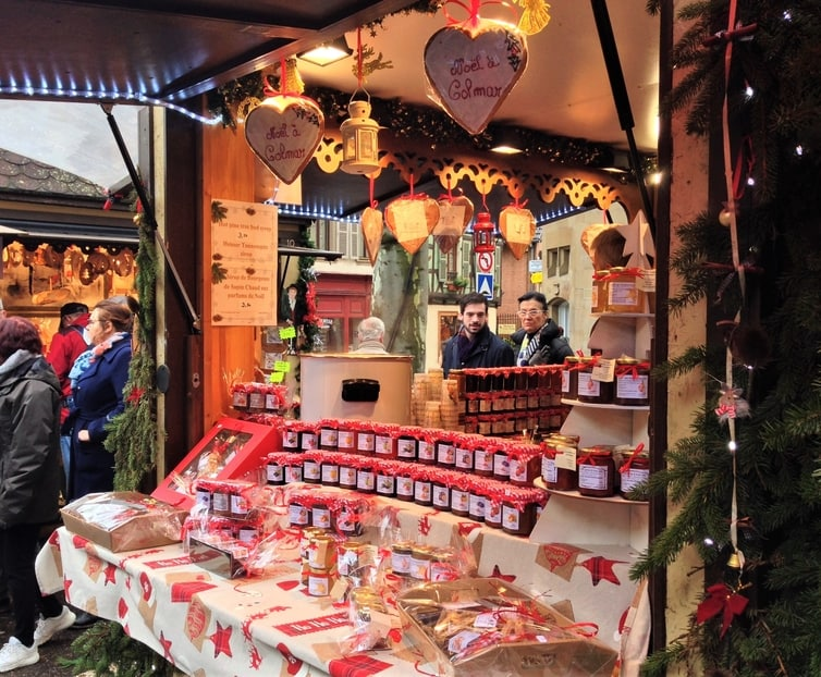 Fountain of Travel Christmas Market in Colmar Place Jeanne D'Arc Jams