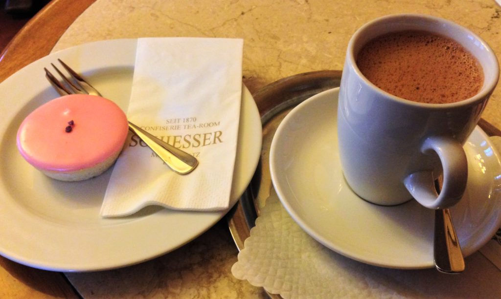 Fountain of Travel Things You Should Do Before Visiting Basel Switzerland Cake and Hot Chocolate in Cafe