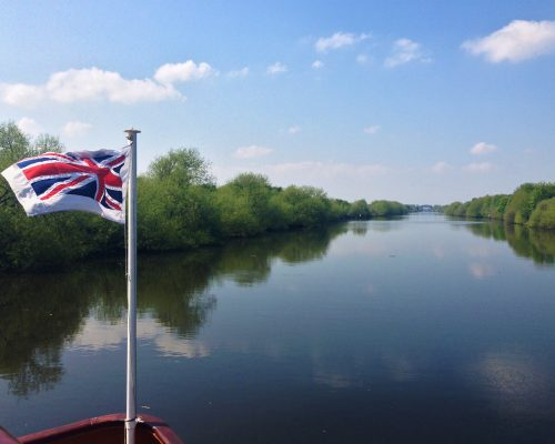 Fountain of Travel How to Cruise Down Manchester Ship Canal Flag on the Boat
